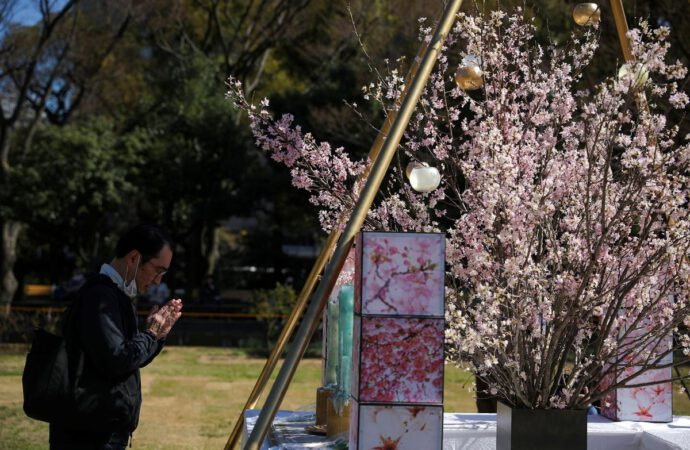 With sadness but no ceremony, Japan marks disaster anniversary